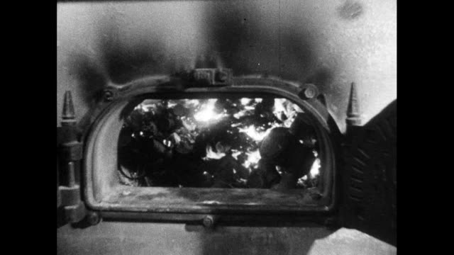 push in to open incinerator door burning trash; 1964 - fossil fuel stock videos & royalty-free footage
