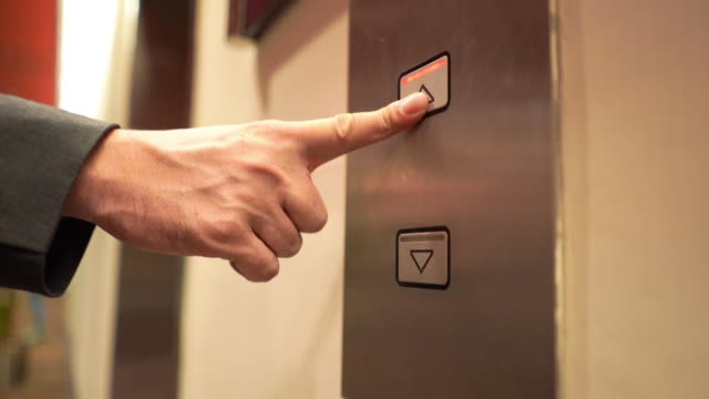 push on the button in an elevator and lift movement - continuity stock videos & royalty-free footage