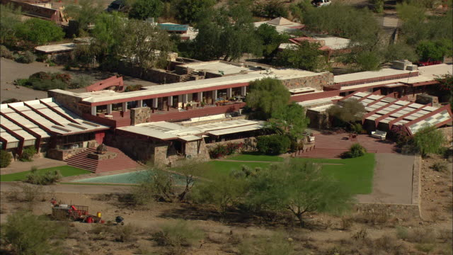 push out shot of taliesin west by frank lloyd wright in arizona - shrubland stock videos & royalty-free footage