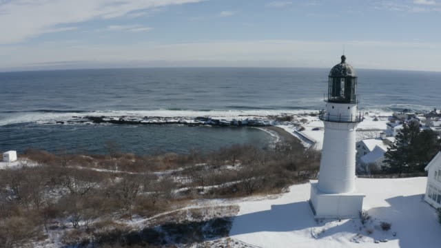 push out shot of the portland head light and a suburb area from the ocean - north atlantic ocean stock videos & royalty-free footage