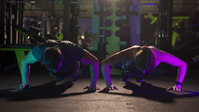 push ups buddies - body building stock videos & royalty-free footage