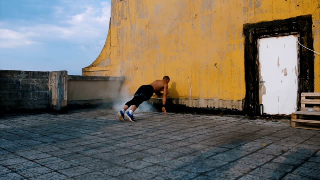 push ups on the roof - tracksuit bottoms stock videos & royalty-free footage