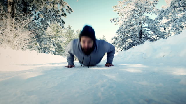 push ups on the snow - hands on stomach stock videos & royalty-free footage