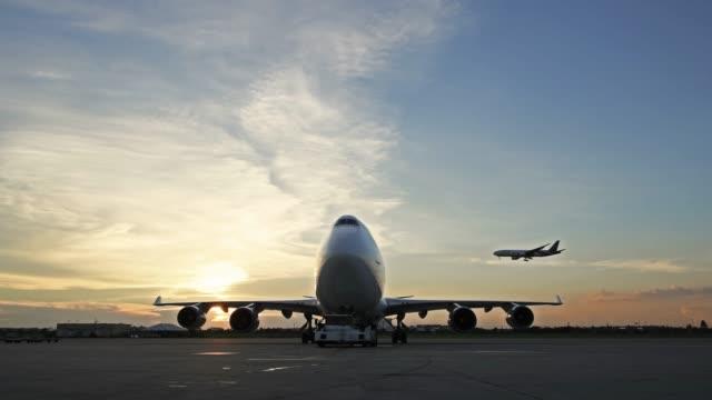 pushback car pushing back aircraft - cargo aeroplane stock videos & royalty-free footage