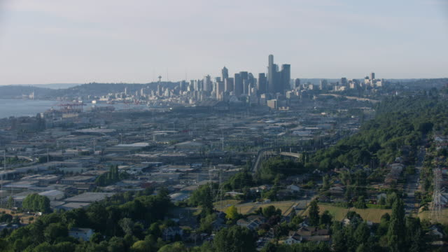 push-in shot of downtown seattle with south seattle in the foreground - seattle stock videos & royalty-free footage