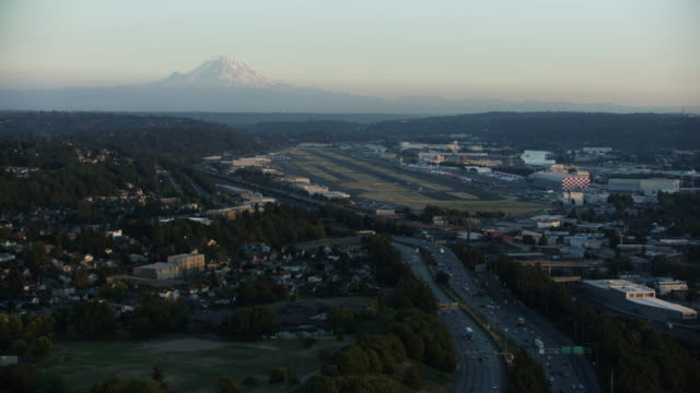 push-in shot of the boeing field with mount rainier in the background - seattle stock-videos und b-roll-filmmaterial
