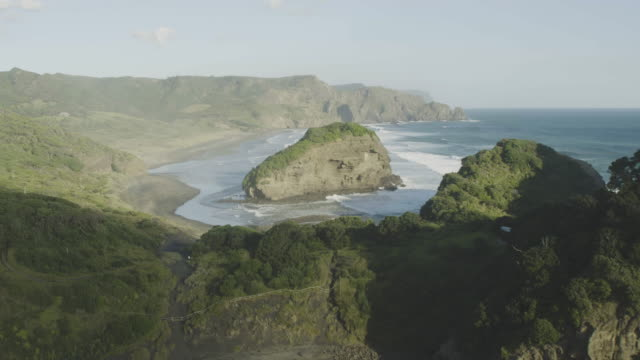 push-in shot of the coast of bethells beach - coastal feature stock videos & royalty-free footage