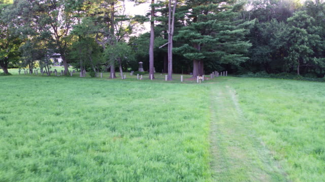 push-in shot of the graveyard by the rebecca nurse homestead - gravestone stock videos & royalty-free footage