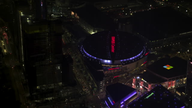 push-in shot of the staples center in downtown los angeles - microsoft theater los angeles stock videos and b-roll footage