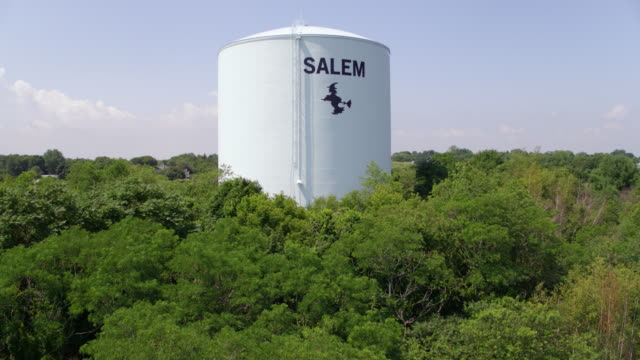 push-in shot of the water tower with the witch logo in salem - salem stock videos & royalty-free footage