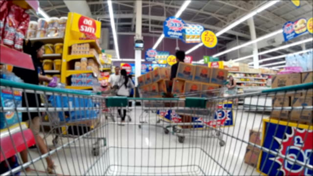 pushing a shopping cart in the supermarket
