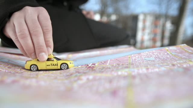 hd: pushing a taxi toy on the map - pushing stock videos & royalty-free footage