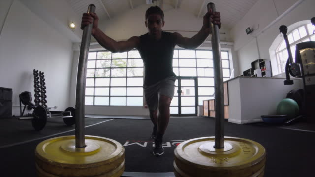 Pushing a Weighted Sled in the Gym