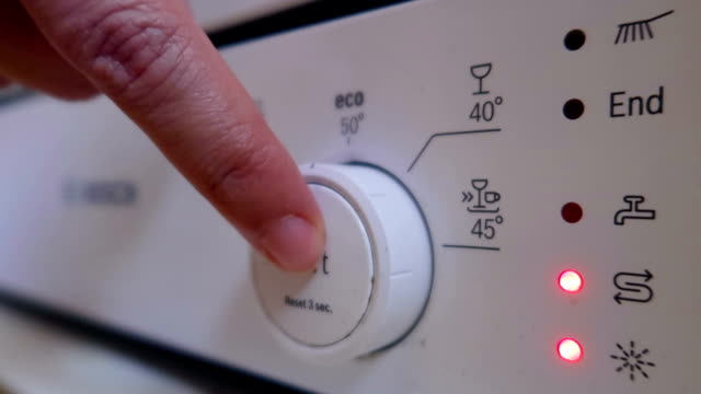 pushing on button on off on dishwasher - stock video - lavastoviglie video stock e b–roll