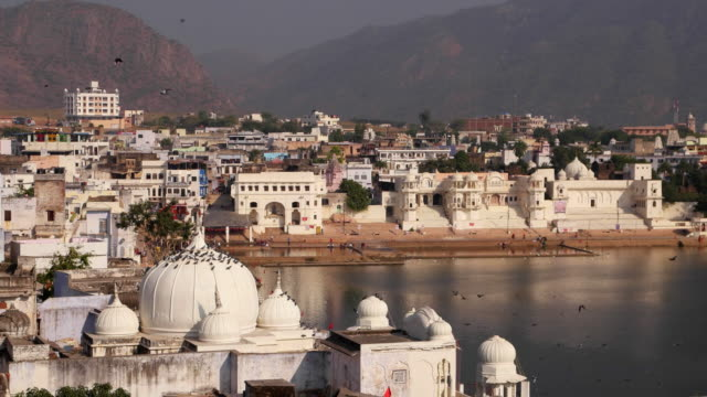 Pushkar lake surrounded by bathing ghats and temple all around in Rajasthan, India