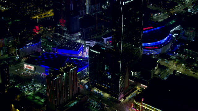 push-out shot of downtown los angeles at night - staples center stock videos and b-roll footage