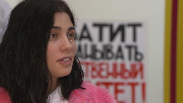 Pussy Riot founder Nadezhda Tolokonnikova interview ENGLAND London Saatchi Gallery INT Reporter asking question SOT Tolokonnikova interview SOT...