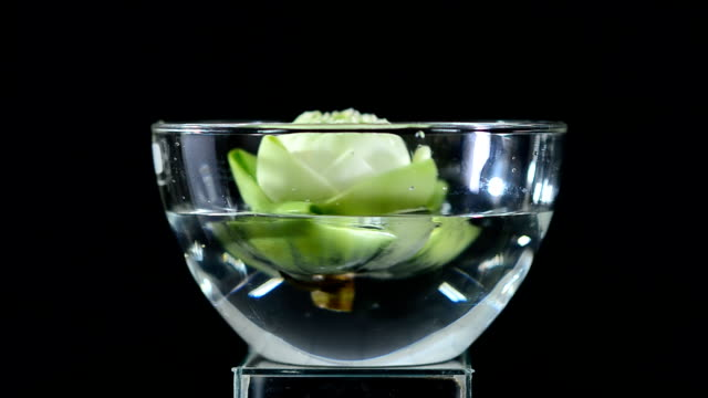 put lotus flower in a glass bowl