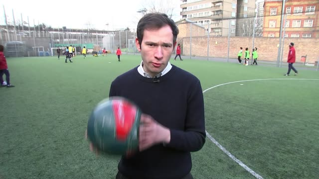 qpr put on free football session for survivors of the grenfell fire children playing football reporter to camera vox pop child shooting at goal... - クイーンズ パーク レンジャーズfc点の映像素材/bロール