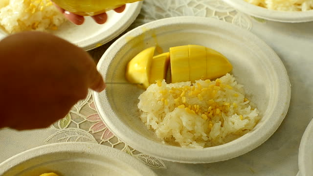 put slice mango into sticky rice - paper plate stock videos & royalty-free footage
