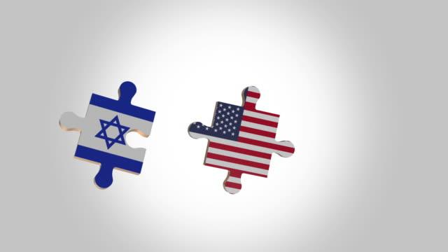 アルファのためのイスラエルとアメリカの旗にパズルを入れて - 地理的地域 国点の映像素材/bロール