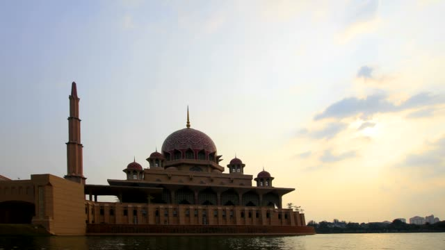 putra mosque at sunset time lapse movie - putrajaya stock videos & royalty-free footage
