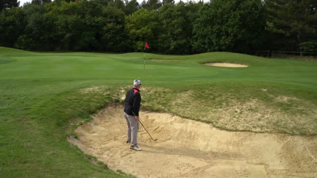 putting a bunker shot on the green. - sand pit stock videos and b-roll footage