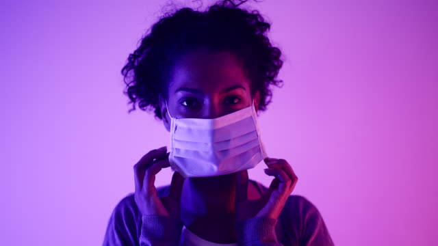 putting a flu mask - applying stock videos & royalty-free footage