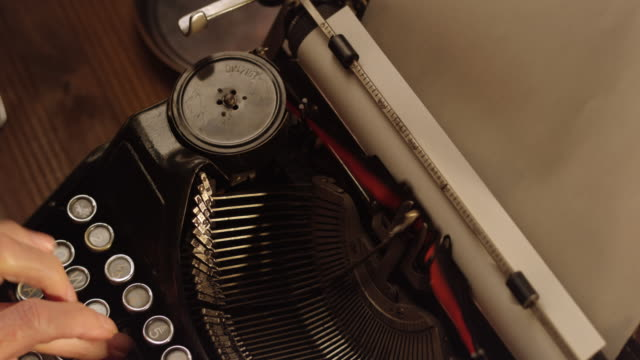 ds putting a paper sheet into old typewriter - inserting stock videos & royalty-free footage