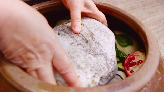 putting a stone weight into a 'jangdok' (korean earthenware) - lettuce stock videos & royalty-free footage