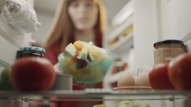 putting bowl of fruit in refrigerator - refrigerator stock videos & royalty-free footage