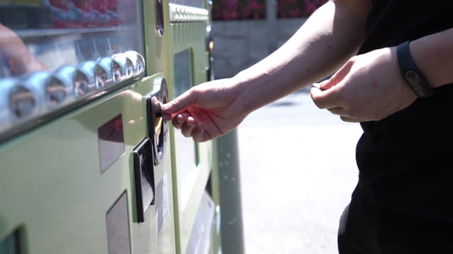 putting coins to vending machine. - inserting stock videos & royalty-free footage