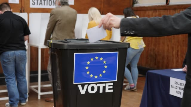 4K DOLLY: Putting European EU Vote in Ballot Box  - Voting at Polling Station