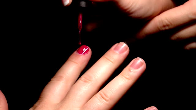 putting finger nail polish on - personal hygiene product stock videos & royalty-free footage