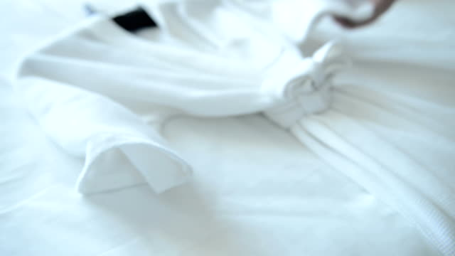 putting fresh towel on bed - hotel stock videos & royalty-free footage