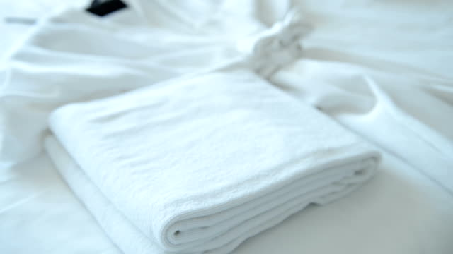 putting fresh towel on bed - towel stock videos & royalty-free footage