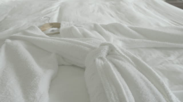 Putting fresh towel on bed
