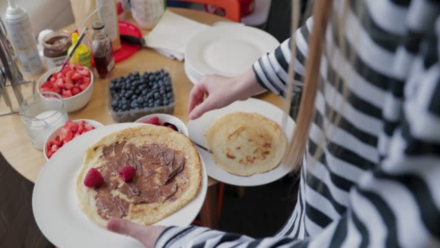 putting fruit on a pancake - blueberry stock videos and b-roll footage