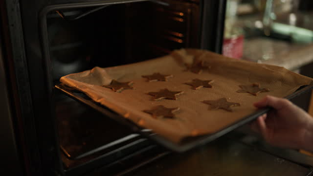 putting gingerbread cookies in the oven - baking tray stock videos & royalty-free footage