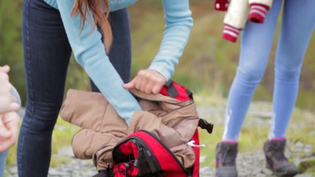 putting jacket in backpack - sportswear stock videos & royalty-free footage
