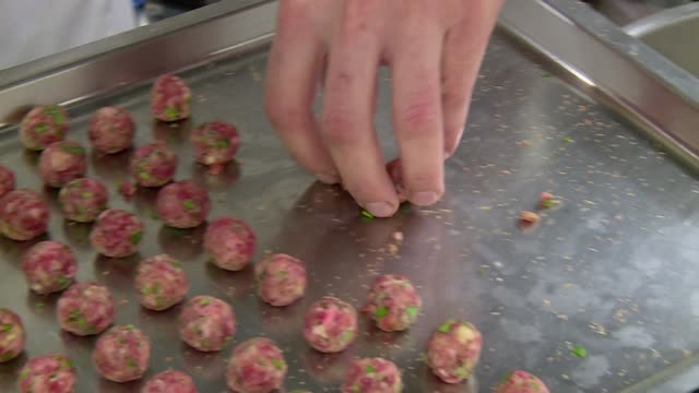 putting meatballs into boiling stew - meatballs stock videos & royalty-free footage