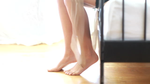 putting on her stockings - stockings stock videos & royalty-free footage