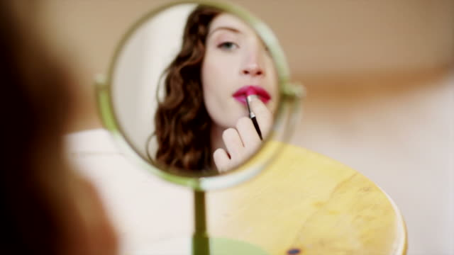 putting on lipstick - make up stock videos & royalty-free footage