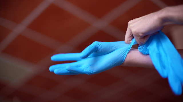 putting on surgery gloves - latex glove stock videos & royalty-free footage