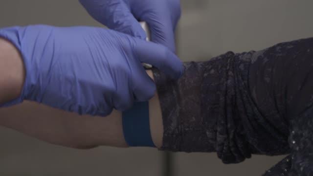 putting on tourniquet - human limb stock videos & royalty-free footage