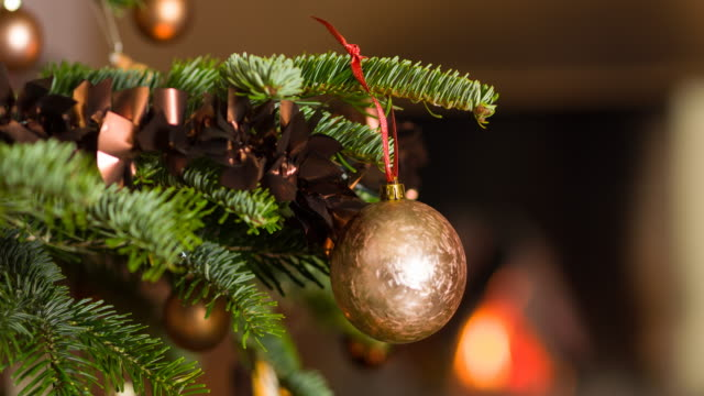 putting ornaments on christmas tree - decoration stock videos & royalty-free footage