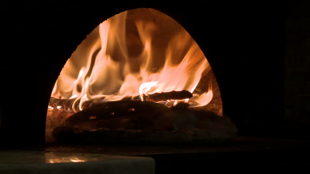 ms putting pizza in wood oven / isernia, molise, italy  - pizza oven stock videos and b-roll footage