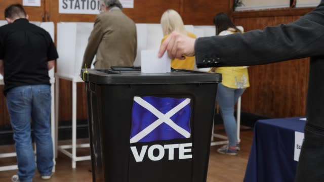 4K DOLLY: Putting Scottish Vote in Ballot Box at the Referendum - Voting at Polling Station