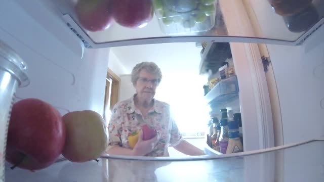 putting shopping in the refrigerator - refrigerator stock videos & royalty-free footage