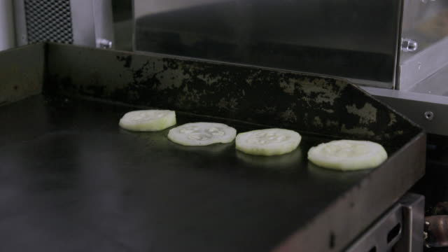 putting slices of zucchini on frying board - uneven stock videos & royalty-free footage